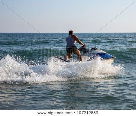 Silhouette Of Man On Jet ski At Sea
