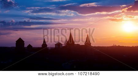 View on the castle in Kamianets Podilskyi in the evening. Ukraine