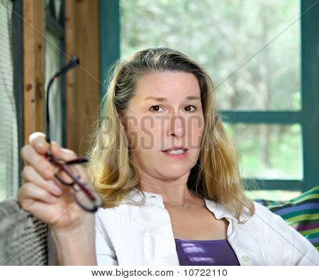 Mature Woman Looking Doubtful And Worried