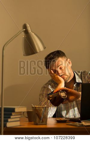 Exhausted Man Sitting At Desk
