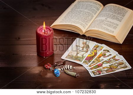 Composition of esoteric objectscandleTarots and book used for healing and fortune-telling. poster