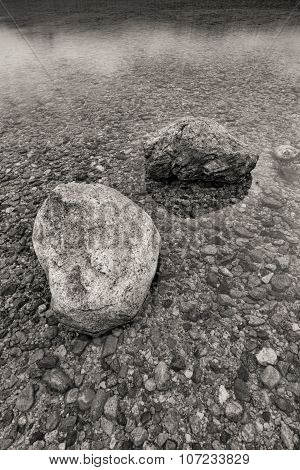 B&w Of Boulders In Shallow Water.