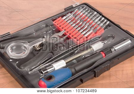 Precision Tool Kit on a wooden desk poster