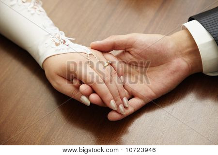 Hands Of Newly-married Couple