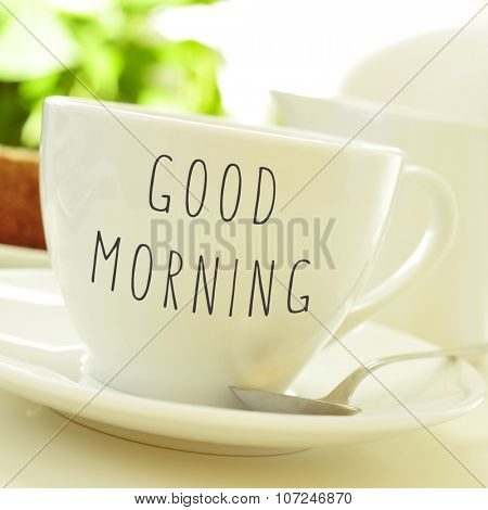 closeup of a cup of coffee or tea with the text good morning written in it