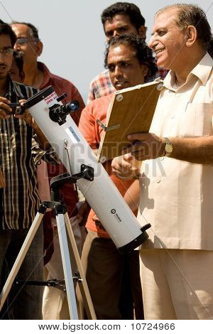 An Astronomer Demonstrates The Projection Method At A Solar Eclipse
