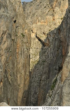 Taurus Mountains. Turkey. Steep cliffs and gorge. Snow-capped peaks. poster