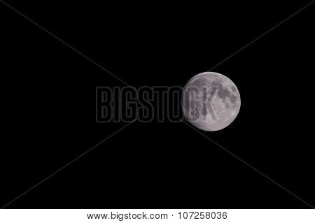 Closeup Of Beautiful Silver Full Moon Over Dark Black Sky At Night
