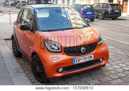 Bright Red Smart Fortwo W453 Stands On Street