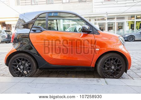 Bright Red And Black Smart Fortwo Car Side View