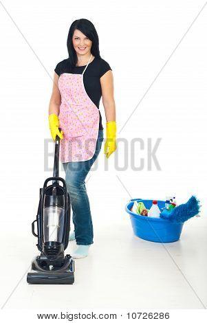 Cute Woman Using Vacuum Cleaner