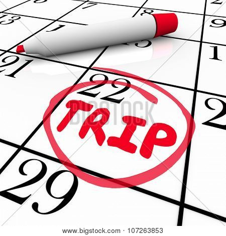 Trip word circled by red pen or marker on calendar to illustrate start of travel, holiday or vacation