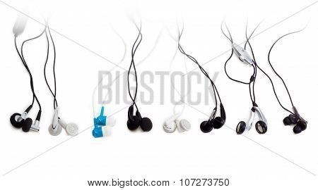 Several Various Earbuds On A Light Background