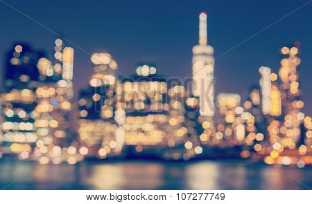 Vintage Toned Blurred Manhattan Waterfront At Night, Nyc, Usa.