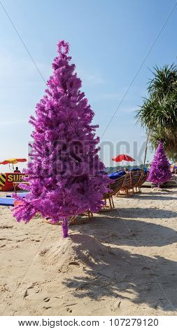 Fake Christmas Tree On Tropical Beach With Chairs And Tables Around