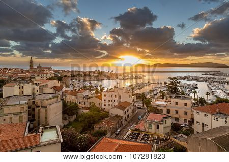Sunset Over City Of Alghero On West Coast Of Sardinia