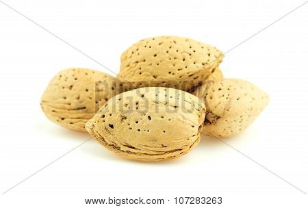 Pile Of Natural Unshelled Almond Nuts Against White Background