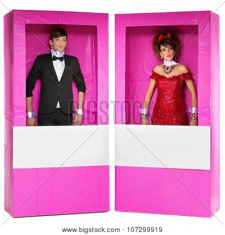 Boy and girl looking like dolls in boxes