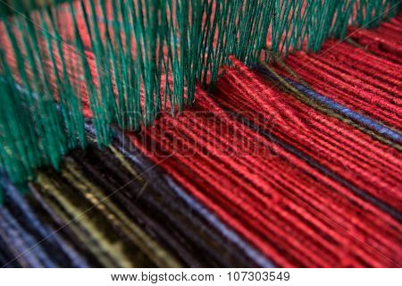 Wool yarn on loom