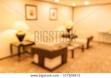 Blurred Photo Of Sofa Set In Hotel Lobby.