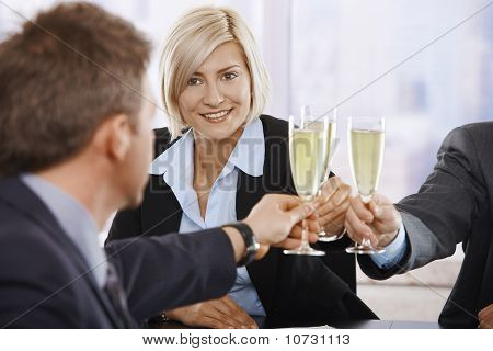 Businesswoman Raising Toast With Champagne