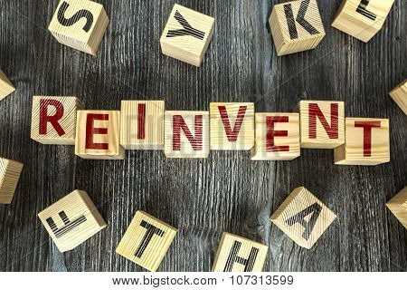 Wooden Blocks with the text: Reinvent