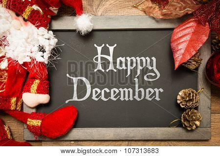 Blackboard with the text: Happy December in a christmas conceptual image