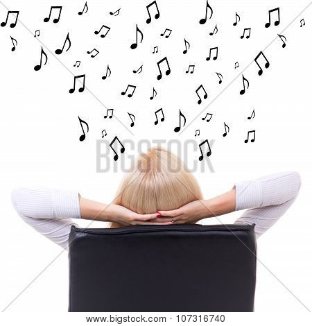 Back View Of Woman Sitting On Office Chair And Listening Music Over White