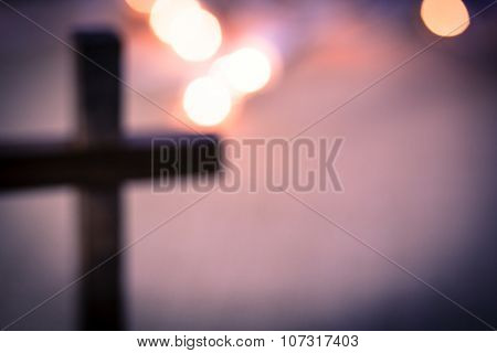 Blurred Christian Cross And Bokeh Lights