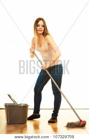 Spring cleaning concept. young woman mopping floor standing with old mop and bucket white background poster