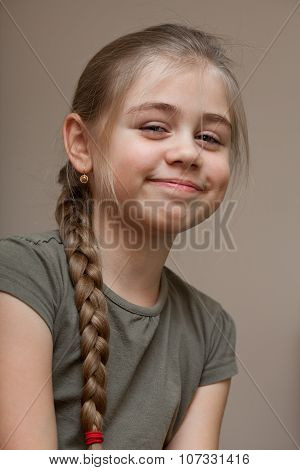 Portrait of the smiling young girl with braided hair poster