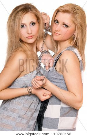 Two Beautiful Young Women Bound A Chain