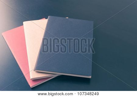 Book On Black Wooden Table Background