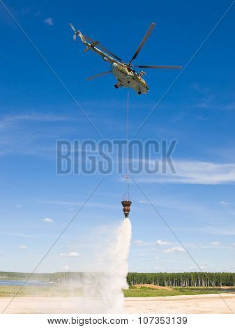 Helicopter MI-8 shows the fire-fighting