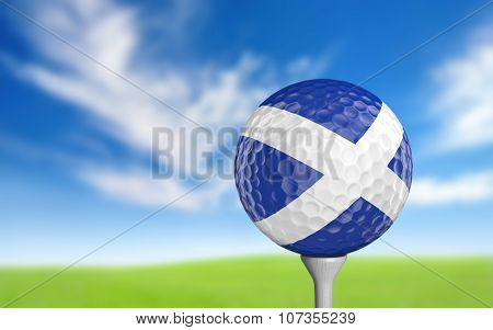 Golf ball with Scotland flag colors sitting on a tee