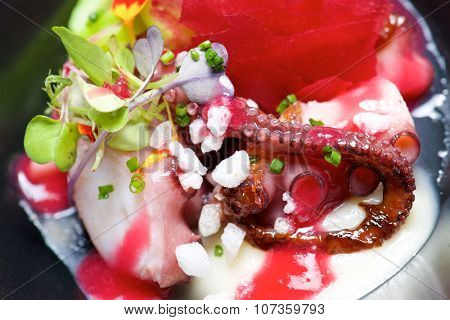 Octopus with vegetables and marinara sauce.