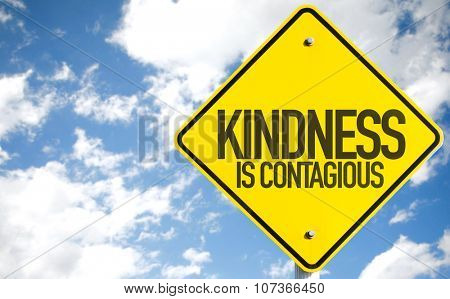 Kindness Is Contagious sign with sky background