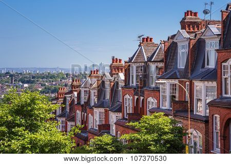 Brick houses of Muswell Hill and panorama of London with Canary Wharf, London, UK