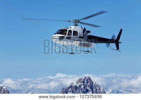 Scenic Helicopter Flies Over The Tops Of The Marmolada, In Front Of The Rope To The Top Of The Cab.