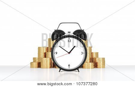 An Alarm Clock Is On The Foreground And Golden Coins Which Are On The Background. A Concept Of Time
