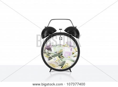 There Is Euro Bills Inside The Alarm Clock Which Is On The Table. The Concept Of 'time Is Money' And