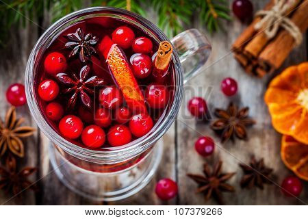 Homemade Mulled Wine With Orange Slices, Cranberries, Cinnamon And Anise