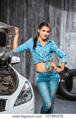 Concept for young sexy female car repair