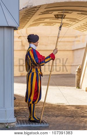 VATICAN CITY, ROME - SEPTEMBER 10:Unidentified Papal Swiss guard standing with a halberd circa September 10, 2015 in Vatican City. Vatican City State is a sovereign city-state within the city of Rome