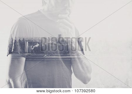 Double exposure of man thinking with hand on chin cityscape in background. poster