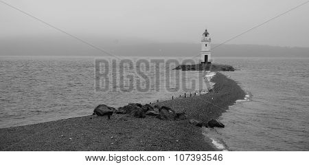 Lighthouse On Foreland In The Sea
