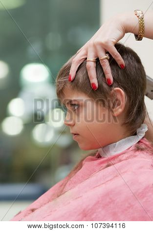 Boy At Hairdresser's Shop