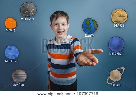 Teen boy smiles and holds out his hand toward a joyful gesture o