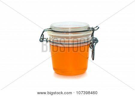 Jar With Honey. Isolated On White.