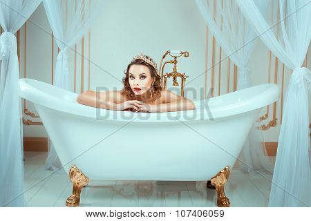 Nude Woman Sitting In Expensive Jewelry Bath.